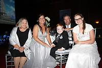 NWA Democrat-Gazette/CARIN SCHOPPMEYER Merolyn Lee [cq] (from left), Amanda Lee,  2017 Champion Child Evan Lee, Brian Lee and Cierra Hathorn enjoy the Color of Hope gala.