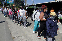 MEDELLIN, COLOMBIA, APRIL 28: People  queue to receive food aid organized by activists, soldiers and police members in a poor neighborhood on April 28, 2020. In Medellín, Colombia. The campaign in Medellín of the ¨Salvar vive ¨ Foundation has benefited the low-income families due to the COVID19 pandemic. (Photo by Fredy Builes/VIEWpress)