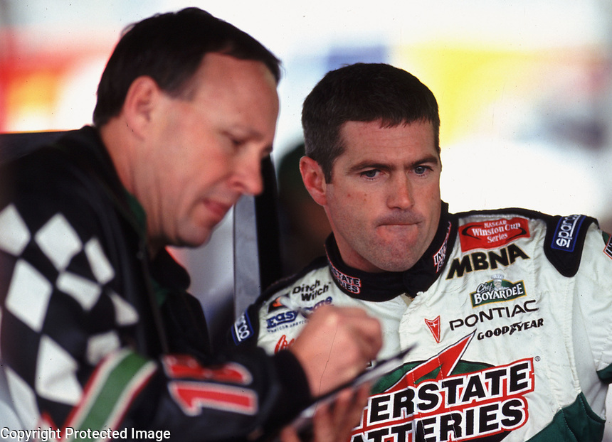 Crew chief Jimmy Makar, left< and Bobby Labonte in the garage area at Phoenix International Raceway in November 2000.(Photo by Brian Cleary)