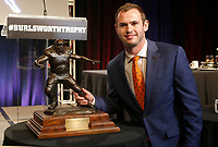 NWA Democrat-Gazette/DAVID GOTTSCHALK Hunter Renfrow, wide receiver at Clemson University, Monday, December 3, 2018, with the 2018 Burlsworth Trophy at the Northwest Arkansas Convention Center in Springdale. The national award is named after Brandon Burlsworth, a former walk-on at the University of Arkansas, and honors the athletic accomplishments of the walk-on student athlete.