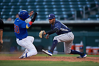 AZL Padres 1 relief pitcher Frank Lopez (17) prepares to apply the tag to Oswaldo Pina (60) during an Arizona League game against the AZL Cubs 1 on July 5, 2019 at Sloan Park in Mesa, Arizona. The AZL Cubs 1 defeated the AZL Padres 1 9-3. (Zachary Lucy/Four Seam Images)