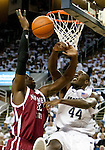 March 1, 2012: New Mexico State Aggies center Hamidu Rahman's shot is blocked by Nevada Wolf Pack forward Dario Hunt during their NCAA basketball game played at Lawlor Events Center on Thursday night in Reno, Nevada.