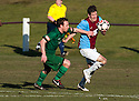 Whitehill's Aaron Somerville tries to get away from Stirling's Matt Sheridan.