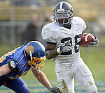 Georgia Southern's Marquice Maynard (26) scoots around SDSU defender Jason Nobiling (90) in the first half of their game Saturday October 29, 2005 at Coughlin Alumni Stadium in Brookings, S.D. (Photo by Dick Carlson/Inertia)