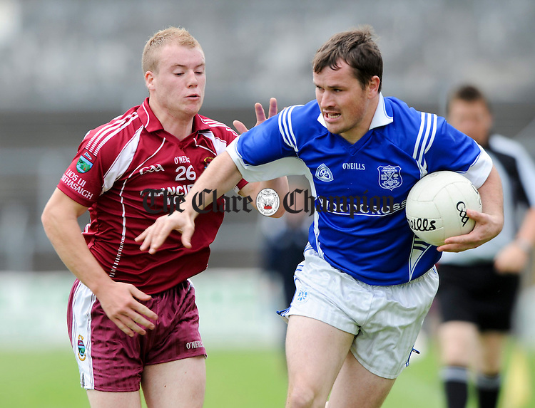 Niall Kelly of Lissycasey in action against Padraig Chaplin of Cratloe during their game at Cusack park. Photograph by John Kelly.