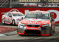 Jamie Whincup leads Jason Richards through Holden Hairpin in Race Two during Day Three of the Hamilton 400 Aussie V8 Supercars Round Two at Frankton, Hamilton, New Zealand on Sunday, 19 April 2009. Photo: Dave Lintott / lintottphoto.co.nz