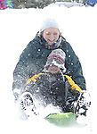 Sentinel/Dan Irving.Elizabeth Tillman of Holland rides down the sledding hill at VanRaalte Farm with her five-year-old son Jacob on Friday morning. .(2/10/06)