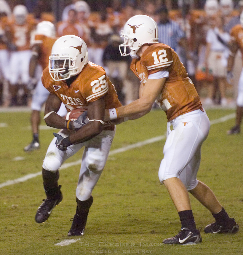 09 September 2006: Texas quarterback Colt McCoy (#12) hands off the ball to Jamaal Charles (#25) during the Texas Longhorns 24-7 loss to the Ohio State Buckeyes at Darrell K Royal Memorial Stadium in Austin, TX.