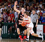 SIOUX FALLS, SD - MARCH 19: Hayden Busch #44 from Huron defends as Carter Keller #20 from Washington tries to drive past him in the second half of their quarterfinal game Thursday afternoon during the Boys State AA Basketball Tournament at the Denny Sanford Premire Center in Sioux Falls, SD. (Photo by Dave Eggen/Inertia)