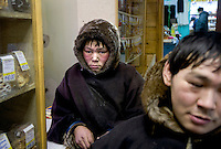 Reindeer herders Simyon and Vanya buy supplies at a small village shop in Sovetsky that they have reached after many hours journey by snowmobile. /Felix Features