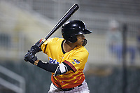 Johan Cruz (5) of the Los Rapidos de Kannapolis at bat against the West Virginia Power at Kannapolis Intimidators Stadium on July 25, 2018 in Kannapolis, North Carolina. The Los Rapidos defeated the Power 8-7 in game two of a double-header. (Brian Westerholt/Four Seam Images)