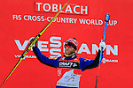 Martin Johnsrud Sundby at the podium of the 10 Km Individual Free race of Tour de ski as part of the FIS Cross Country Ski World Cup  in Dobbiaco, Toblach, on January 8, 2016. Finn Haagen Krogh wins the stage. Martin Johnsrud Sundby (2nd) remains leader. French Maurice Manificat is third. Credit: Pierre Teyssot