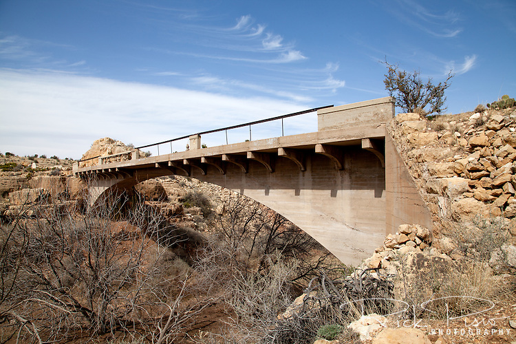 Padre Canyon Bridge spans the Padre Canyon in Arizona, east of Flagstaff. Once part of the National Old Trails Highway, and later Route 66, it's construction allowed vehicles to pass over Padre Canyon whose steep canyon walls were a major transportation obstacle on the relatively flat Arizona high desert since the days of the Winona-Flagstaff Road. The bridge, classified as a Luten Bridge, was enginereed by Daniel B. Luten and built by the Topeka Bridge and Iron Co. in 1914 for a total cost of $7,900. On September 30, 1988 it was added to the National Register of Historic Places.