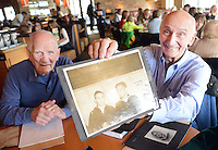 Ralph Kelly (left), 90 of Plymouth Meeting, Pennsylvania looks on as Bernie Gerson, 90, of Warrington, Pennsylvania holds a photo showing themselves (Bernie on left, Ralph on right)  in World War II after they met for the first time since World War II 70 years ago Saturday February 20, 2016 at California Kitchen in Plymouth Meeting, Pennsylvania. (Photo by William Thomas Cain)