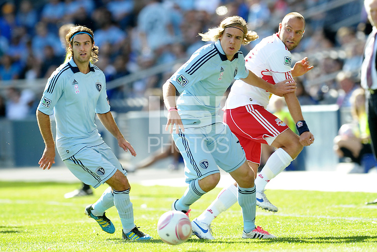 Graham Zusi, Chance Myers Sporting KC,Joel Lindpere Red Bulls watch the ball go by...Sporting Kansas City defeated New York Red Bulls 2-0 at LIVESTRONG Sporting Park, Kansas City, Kansas.