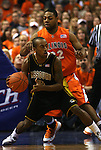 23 December 2008:    Mizzou's Miguel Paul (3, foreground) is guarded closely by Illini's Demetri McCamey (32, rear) during the first half.  The University of Missouri and the University of Illinois competed in the annual Busch Braggin' Rights basketball game at the Scottrade Center in downtown St. Louis, Missouri on Tuesday December 23, 2008...