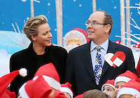 Princess Charlene of Monaco and Prince Albert attend the Children's Christmas Ceremony - Monaco