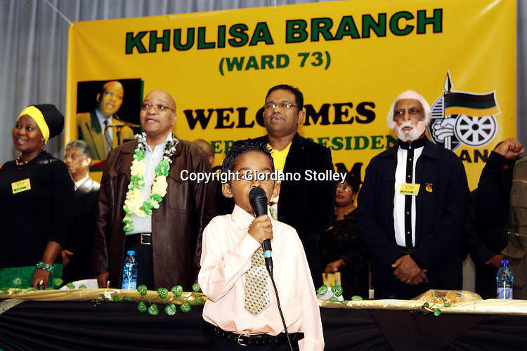 DURBAN - 26 May 2007 - Little Zachariah Moodley leads members of the African National Congress' Khulisa branch in singing the national anthem. Behind him are (from left) Khumbu Mkhize, a Chatsworth ANC zonal secretary, ANC deputy president Jacob Zuma, ANC councillor Visvin Reddy and ANC member of the national parliament Kay Moonsamy. Zuma attended the celebration of the 60th anniversary of the so-called Three Doctors' Pact..Picture: Giordano Stolley/Allied Picture Press