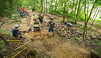 NWA Democrat-Gazette/BEN GOFF @NWABENGOFF<br /> Volunteers with Ozarks Off Road Cyclists add rock armoring Saturday, July 6, 2019, at the intersection of Last Call and Terrapin Station at Kessler Mountain Regional Park in Fayetteville. Volunteers used 11 tons of stone to shore up the often muddy and erosion-damaged section of the trail and recently completed similar projects on other trails at the park. The Ozark Off Road Cyclists, the local chapter of the International Mountain Bicycling Association, are raising funds through their Kessler Campaign to fund further improvements and future trails at the park.