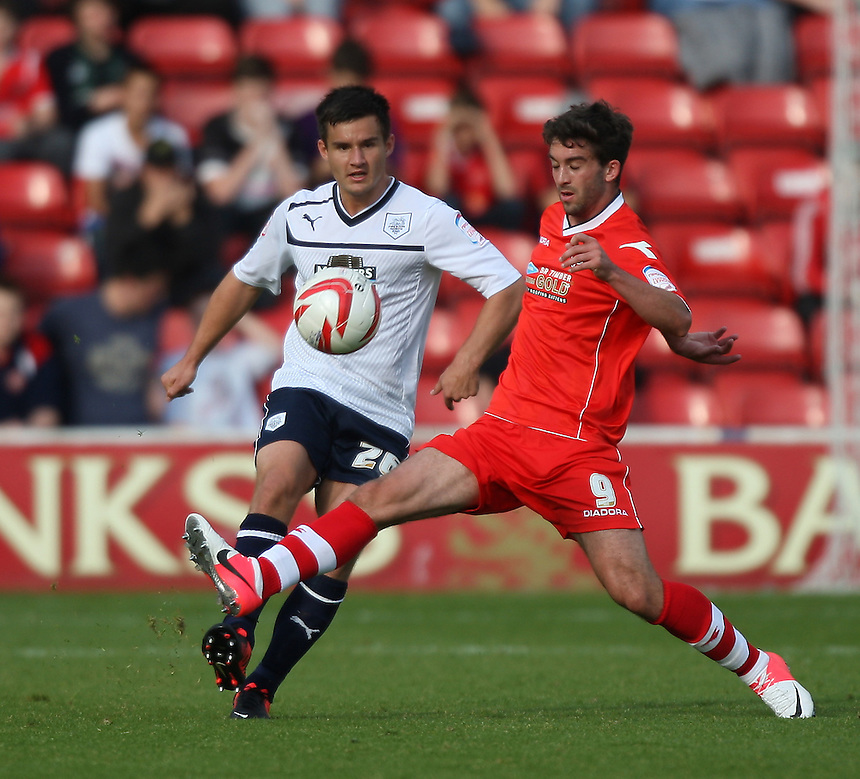 Preston North End's Bailey Wright in action with Will Grigg..Football - npower Football League Division One - Walsall v Preston North End - Saturday 22nd September 2012 - Banks's Stadium - Walsall..