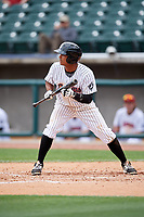 Birmingham Barons shortstop Cleuluis Rondon (7) squares around to bunt during a game against the Jacksonville Jumbo Shrimp on April 24, 2017 at Regions Field in Birmingham, Alabama.  Jacksonville defeated Birmingham 4-1.  (Mike Janes/Four Seam Images)
