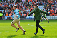 Blackpool fans invade the pitch after their team's second goal<br /> <br /> Photographer Richard Martin-Roberts/CameraSport<br /> <br /> The EFL Sky Bet League One - Blackpool v Fleetwood Town - Monday 22nd April 2019 - Bloomfield Road - Blackpool<br /> <br /> World Copyright © 2019 CameraSport. All rights reserved. 43 Linden Ave. Countesthorpe. Leicester. England. LE8 5PG - Tel: +44 (0) 116 277 4147 - admin@camerasport.com - www.camerasport.com