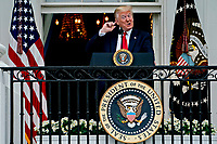 United States President Donald J. Trump arrives to speak from the Blue Room Balcony of the White House during a Rolling to Remember ceremony honoring the nation's veterans and prisoners of war/missing in action (POW/MIA) in Washington, D.C., U.S., on Friday, May 22, 2020. Trump didn't wear a face mask during most of his tour of Ford Motor Co.'s ventilator facility Thursday, defying the automaker's policies and seeking to portray an image of normalcy even as American coronavirus deaths approach 100,000. <br /> Credit: Andrew Harrer / Pool via CNP /MediaPunch