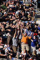 Fans reach for a ball hit into the stands. The Philadelphia Union and the Kansas City Wizards played to a 1-1 tie during a Major League Soccer (MLS) match at PPL Park in Chester, PA, on September 04, 2010.