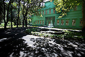 At the country house (dacha) of Joseph Stalin (1878-1953), former leader of the Soviet Union. The residence, in which Stalin spent his last decade, has never been open to the public.