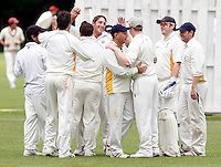 I Barrie (C - facing) is mobbed after dismissing Mark Askew of North London during the Middlesex County Cricket League Division Three game between North London and Bessborough at Park Road, Crouch End on Saturday June 12, 2010