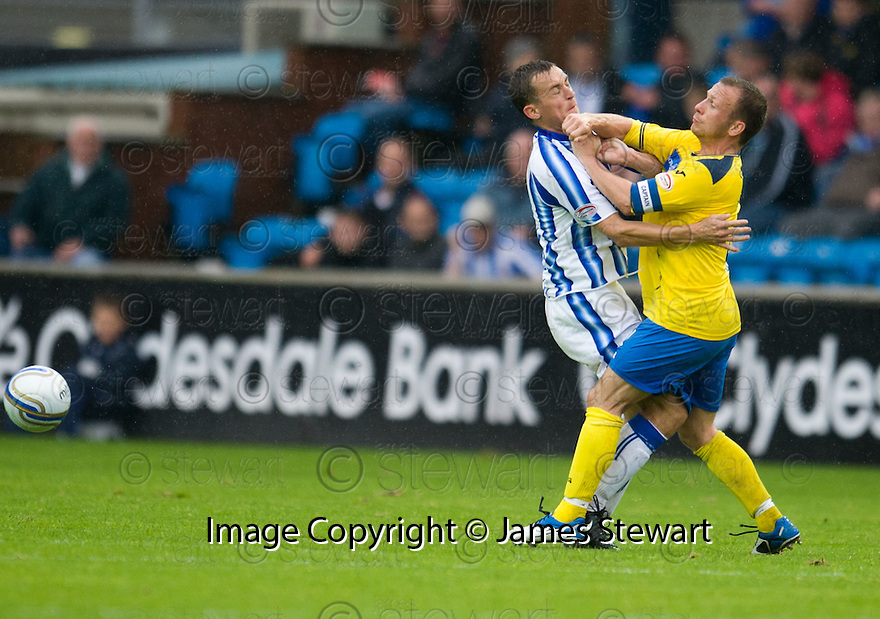 KILMARNOCK'S JAMES FOWLER COLLIDES WITH ST JOHNSTONE'S JODY MORRIS