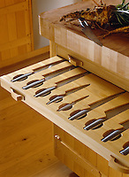 A specially designed knife drawer with recesses made to fit each knife protect the blades and make the knives easily identifiable