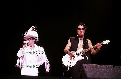 Jane's Addiction - vocalist Perry Farrell and guitarist Dave Navarro performing live on Day One on the Main Stage at the Reading Festival in the UK - 23 Aug 2002.  Photo credit: Tony Woolliscroft/IconicPix