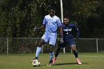 CARY, NC - NOVEMBER 19: North Carolina's Jelani Pieters (26) and UNCW's Jamil Gracia (3). The University of North Carolina Tar Heels hosted the UNCW Seahawks on November 19, 2017 at Koka Booth Stadium in Cary, NC in an NCAA Division I Men's Soccer Tournament Second Round game. UNC won the game 2-1.