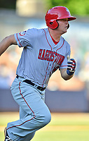 Hagerstown Suns shortstop Sheldon Neuse (16) runs to first base during a game against the  Asheville Tourists at McCormick Field on May 13, 2017 in Asheville, North Carolina. The Suns defeated the Tourists 9-5. (Tony Farlow/Four Seam Images)