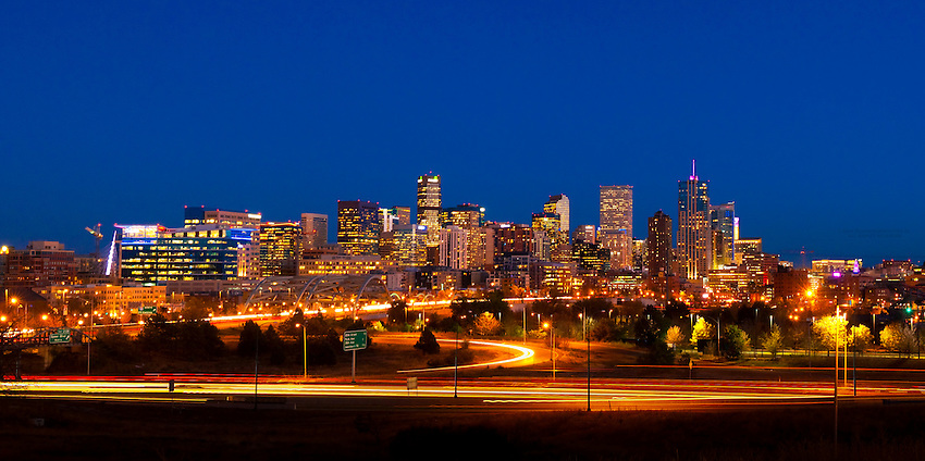 Panoramic view of Downtown Denver skyline with Interstate 25 in the foreground, Denver, Colorado USA.