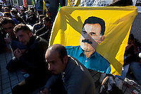 Kurdish hunger strikers hold a flag with a photo of Kurdish political leader Abdullah Ocalan on it outside the United Nations University in Omote Sando, Tokyo, Japan. Friday November 9th 2012. The strike lasted from 8am to 8pm to show solidarity with nearly 800 Kurdish political prisoners held in Turkey who have been on hunger strike for 2 months