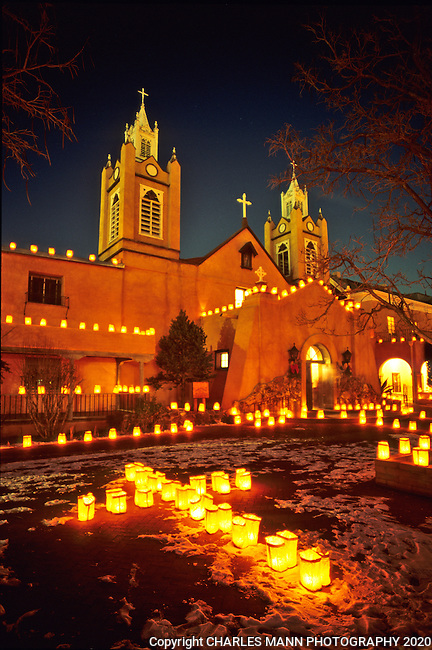 At the Old Town plaza in Albuquerque, the San Felipe de Neri church is decorated with hundreds of faralitos, sometimes called lunimarias, during the celebration on Christmas Eve.