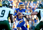 BROOKINGS, SD - SEPTEMBER 6:  Zach Lujan #16 from South Dakota State University scrambles away from Burton De Koning #11 from Cal Poly in the first half of their game Saturday evening at Coughlin Alumni Stadium in Brookings.(Photo/Dave Eggen/Inertia)