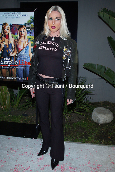 "Alxis Arquette arriving at the premiere party for "" The Simple Life "", reality show at the Bliss Restaurant in Los Angeles. december 2, 2003."