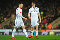 (L-R) Connor Roberts speaks with George Byers of Swansea City during the Sky Bet Championship match between Norwich City and Swansea City at Carrow Road in Norwich, England, UK. Friday 08 March 2019