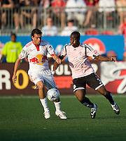 24 June2009: New York Red Bulls midfielder Jorge Rojas #13 and Toronto FC defender Nana Attakora-Gyan #3 in action at BMO Field in Toronto, in a game between the New York Red Bulls and Toronto FC. Toronto FC won 2-0..