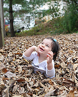 A baby plays in leaves in Albemarle, VA.  Credit Image: © Andrew Shurtleff