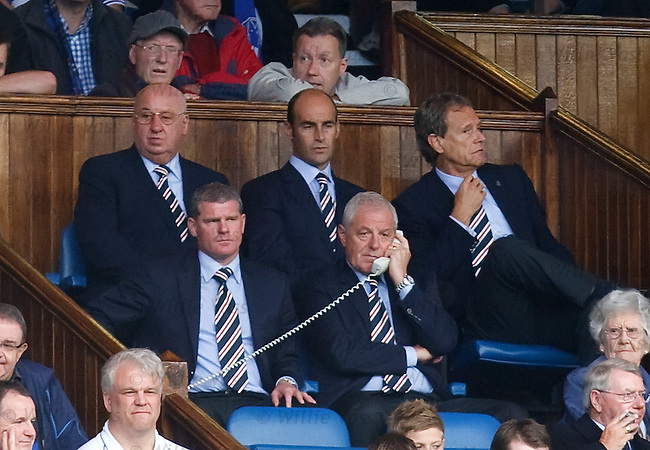 Walter Smith on the hotline as new chairman Alistair Johnston looks on
