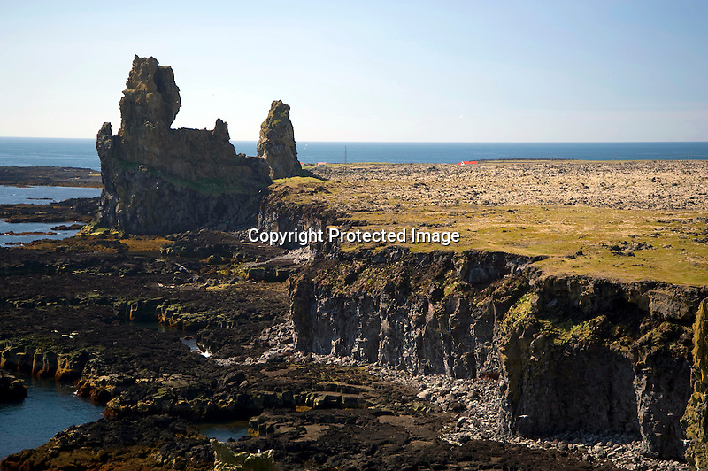Rock Pillars of Londrangar along the Rocky Coast of Hellnar in West Iceland
