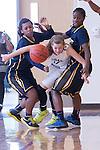 Cedar Ridge Raider Melinda Merritt attempts to escape the pressure of Stony Point defenders Miranda Spearman (left) and Doriana Brown Saturday at Cedar Ridge Gym.  The Raiders beat the Tigers 66-58 in conference play.  (LOURDES M SHOAF for Round Rock Leader.)