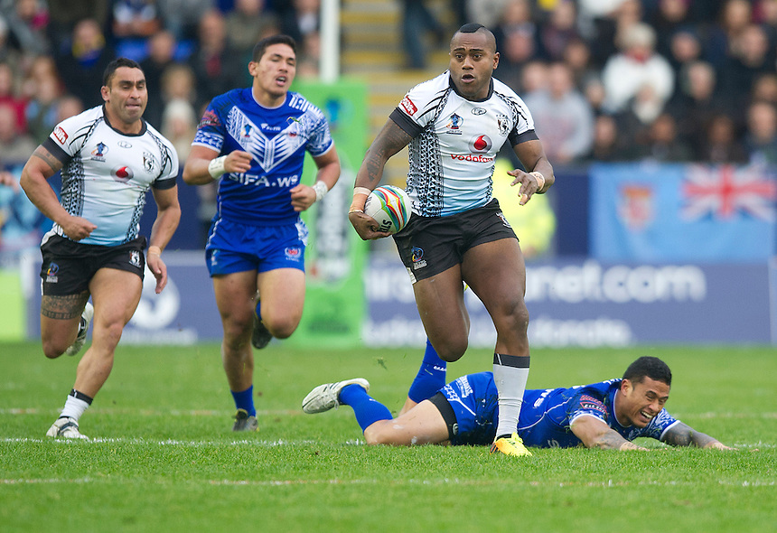 Fiji's Akuila Uate leads a charge out of defence<br /> <br /> Photo by Stephen White/CameraSport<br /> <br /> 2013 Rugby League World Cup - Quarter Final - Samoa v Fiji - Sunday 17th November 2013 - Halliwell Jones Stadium - Warrington<br /> <br /> &copy; CameraSport - 43 Linden Ave. Countesthorpe. Leicester. England. LE8 5PG - Tel: +44 (0) 116 277 4147 - admin@camerasport.com - www.camerasport.com