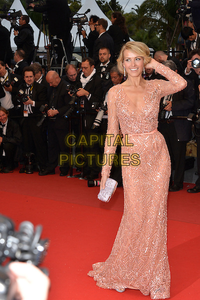 Petra Nemcova. 'All is Lost' premiere at 66th Cannes Film Festival, France 22nd May 2013.full length pink dress beads beaded belt silver clutch bag long sleeves hand arm touching hair sheer.CAP/PL.©Phil Loftus/Capital Pictures.