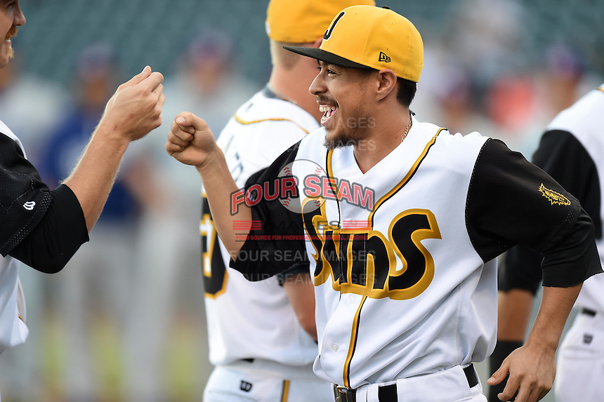 Jacksonville Suns second baseman Alfredo Lopez (2) during introductions before game three of the Southern League Championship Series against the Chattanooga Lookouts on September 12, 2014 at Bragan Field in Jacksonville, Florida.  Jacksonville defeated Chattanooga 6-1 to sweep three games to none.  (Mike Janes/Four Seam Images)