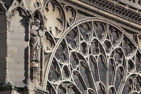 Section of the Southern facade of Notre Dame, begun 1258 by Jean de Chelles, with a statue in a niche and part of the South rose window, built 1260 and designed by Jean de Chelles and Pierre de Montreuil, Ile de la Cite, Paris, France. The cathedral was built 1160-1345 and listed as a UNESCO World Heritage Property in 1991 as part of the Banks of the Seine. Picture by Manuel Cohen